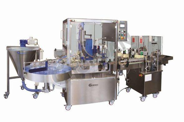 AUTOMATIC FILLING CAPPING AND LABELLING MACHINE WITH TURNTABLE
