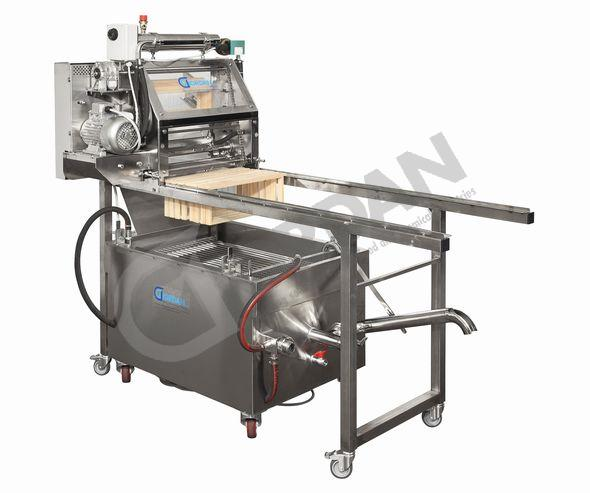 DISOMELTER. UNCAPPING MACHINE WITH DIRECT MELTER